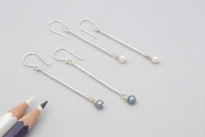 Sterling silver earrings with natural pearl